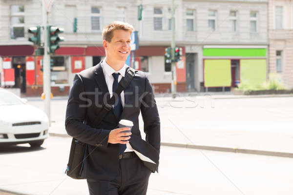 Young Businessman Walking On Street Stock photo © AndreyPopov