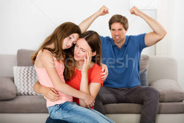 Mother And Daughter Depressed With Violent Father Stock photo © AndreyPopov