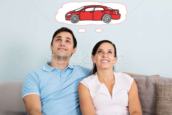 Couple Dreaming Of Having Car Stock photo © AndreyPopov