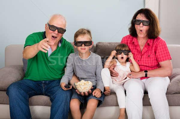 Grandparent And Grandchildren Watching 3D Movie Stock photo © AndreyPopov