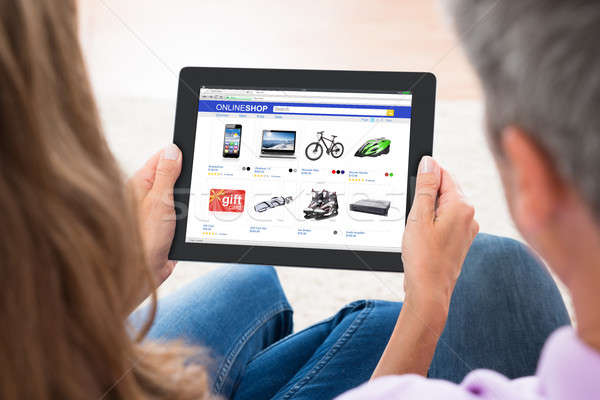 Couple Shopping Online On Digital Tablet Stock photo © AndreyPopov