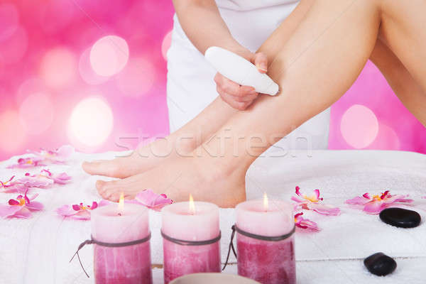 Beautician Using Laser Machine On Customer's Leg Stock photo © AndreyPopov