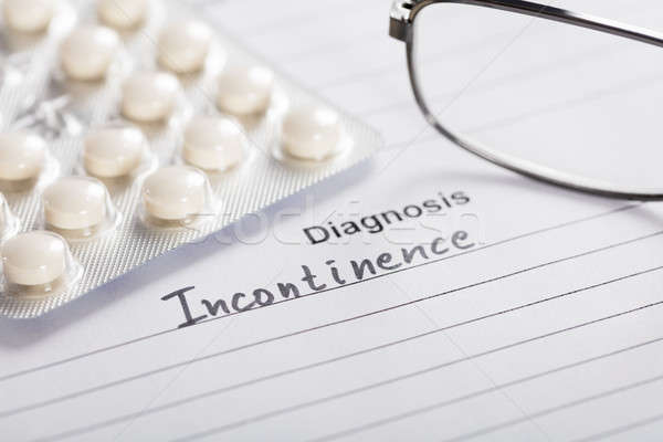 Drug And Glasses On Paper With Text Diagnosis Incontinence Stock photo © AndreyPopov