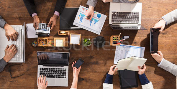 Stock photo: Hands Of Businesspeople On Office Desk