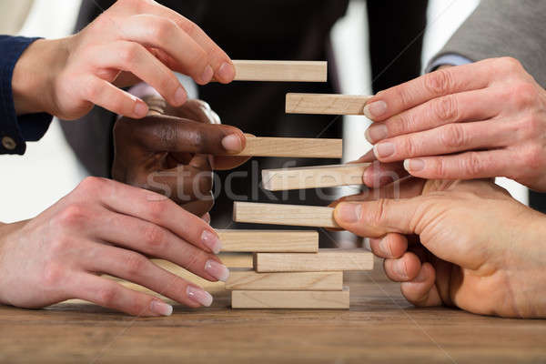 Businesspeople Stacking Wooden Blocks Stock photo © AndreyPopov