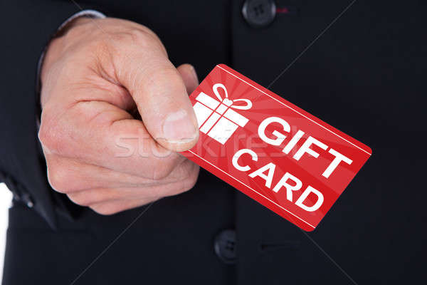 Man's Hand Holding Gift Card Stock photo © AndreyPopov