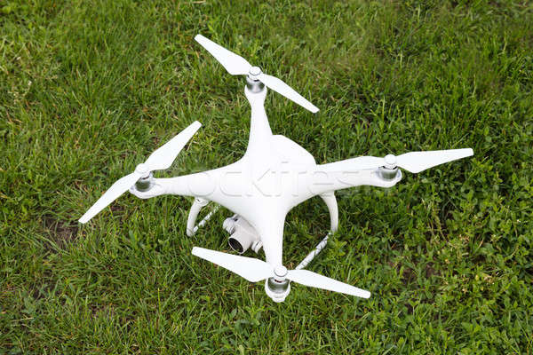 Closeup of white drone on grassy field Stock photo © AndreyPopov