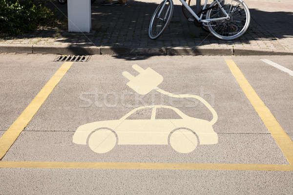 Electric car sign in parking area Stock photo © AndreyPopov