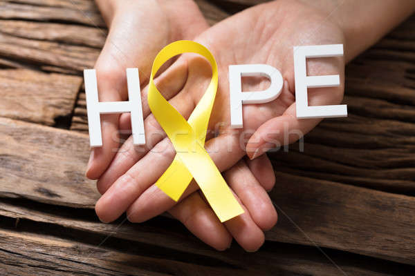 Hand Showing Ribbon With Hope Text Stock photo © AndreyPopov
