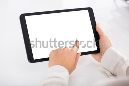 Human Hand Holding Digital Tablet Stock photo © AndreyPopov