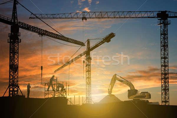 Mensen bouwplaats werk zonsondergang metaal groep Stockfoto © AndreyPopov