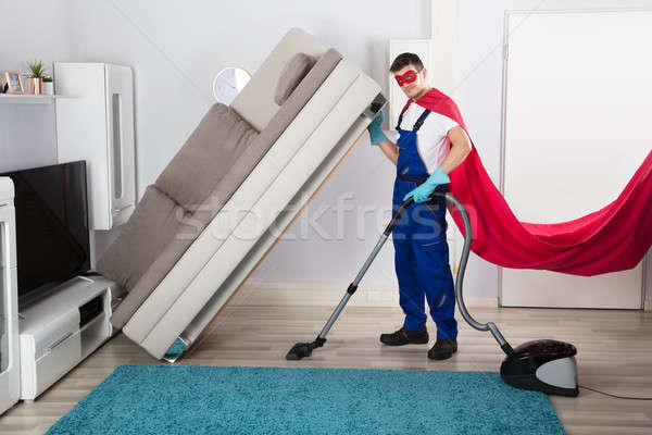 Janitor In Superhero Costume Cleaning Floor Stock photo © AndreyPopov