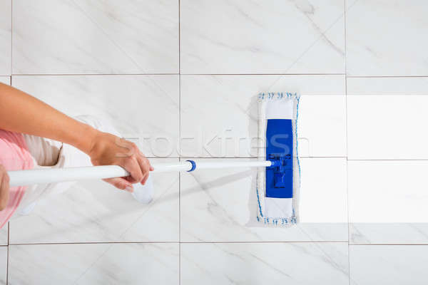 Person Cleaning Floor With Mop Stock photo © AndreyPopov