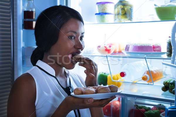 Close-up Of A Woman Eating Cookie Stock photo © AndreyPopov