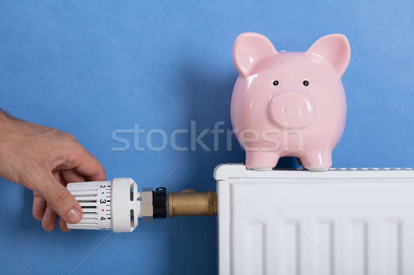 Man's Hand Adjusting Thermostat Stock photo © AndreyPopov