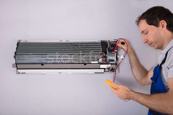 Stock photo: Technician Testing Air Conditioner