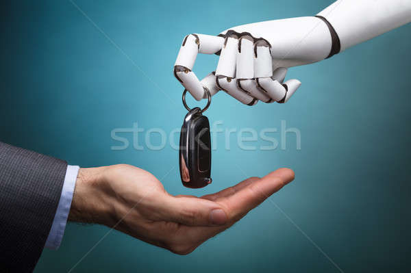 Robot Giving Car Key To Businessperson Stock photo © AndreyPopov
