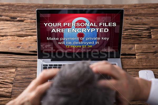Néz laptop képernyő mutat személyes akták Stock fotó © AndreyPopov