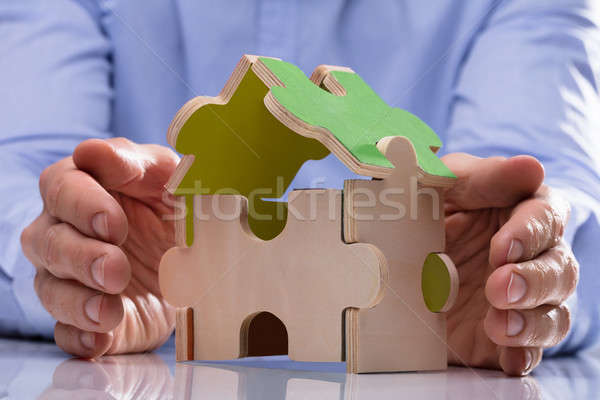 Person Protecting House Model Stock photo © AndreyPopov
