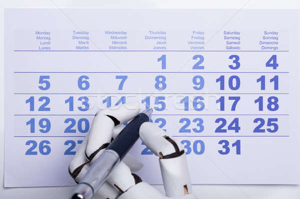 Robot Marking Date On Calendar Stock photo © AndreyPopov