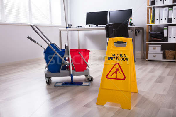 Wet Floor Caution Sign On Floor Stock photo © AndreyPopov