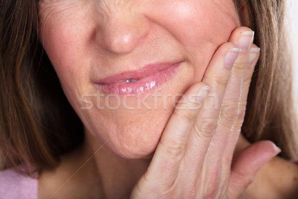 Vrouw lijden kiespijn wang pijnlijk Stockfoto © AndreyPopov