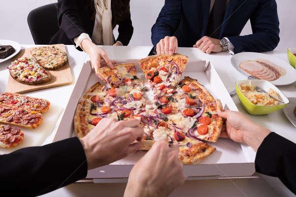Friends Picking Slice Of Pizza Stock photo © AndreyPopov