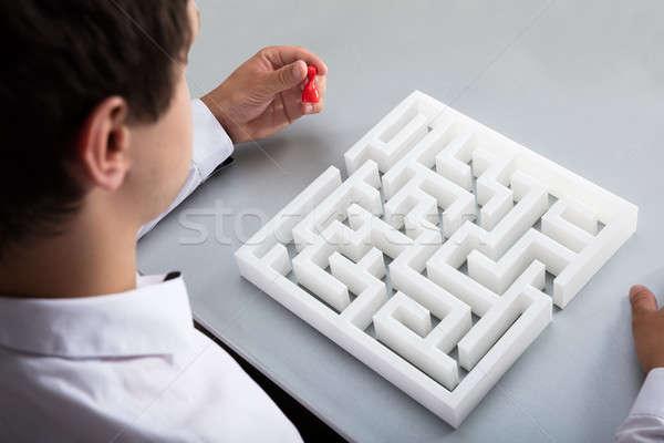 Businessman holding pawn solving maze Stock photo © AndreyPopov