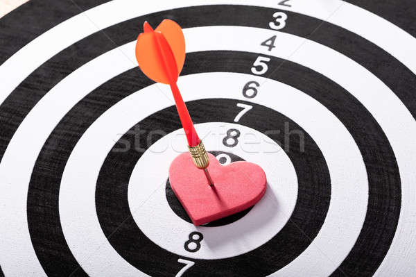 Dart Arrow Hits On Heart Shape On Dartboard Stock photo © AndreyPopov