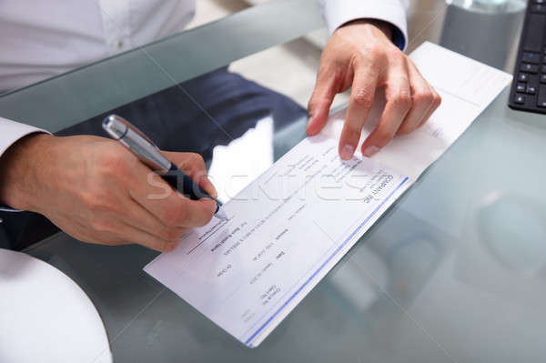 Businessman Signing Cheque Stock photo © AndreyPopov