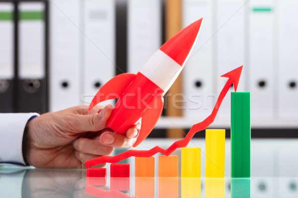 Empresário voador foguete colorido gráfico seta Foto stock © AndreyPopov
