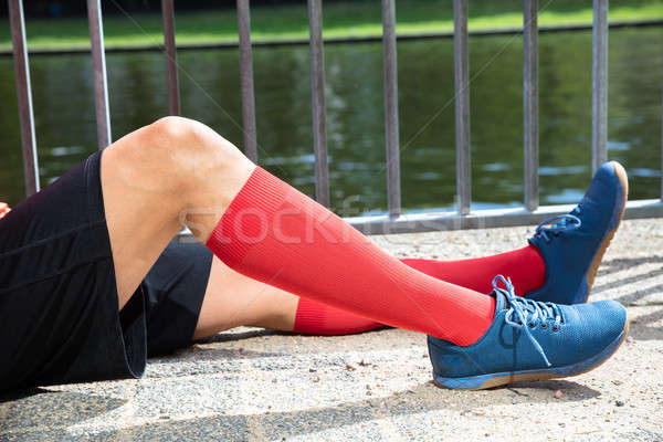 Low Section View Of A Male Jogger's Feet Stock photo © AndreyPopov
