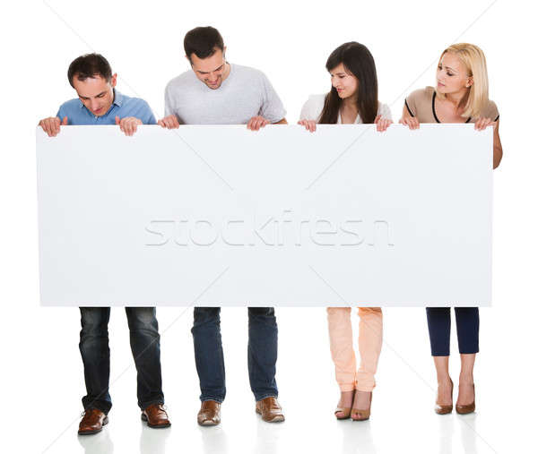 Group Of Friends Holding Placard Stock photo © AndreyPopov