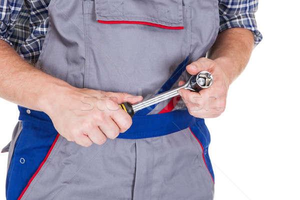 Happy male mechanic holding ratchet Stock photo © AndreyPopov