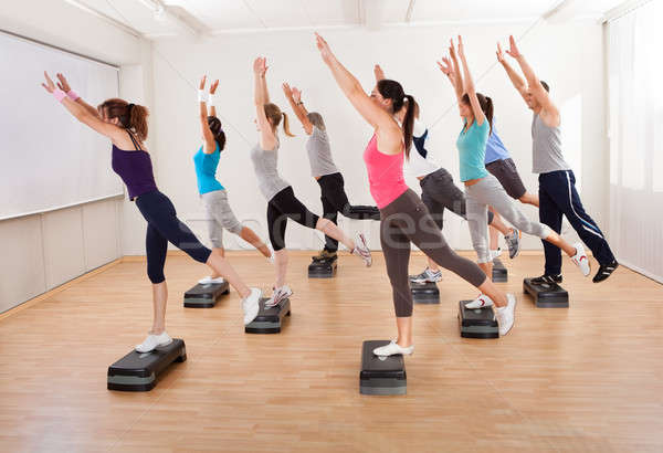 Class doing aerobics balancing on boards Stock photo © AndreyPopov