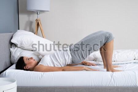 Donna mobile bella donna indietro letto Foto d'archivio © AndreyPopov