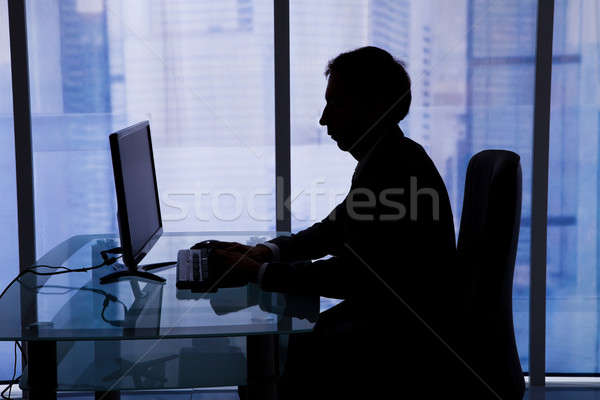 Businessman Using Computer In Office Stock photo © AndreyPopov