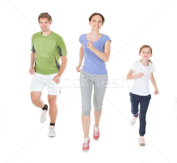 Family Jogging Against White Background Stock photo © AndreyPopov