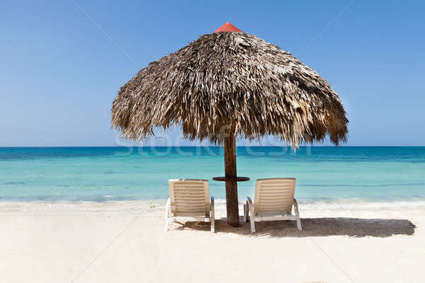 Lounge chairs under sunshade Stock photo © AndreyPopov