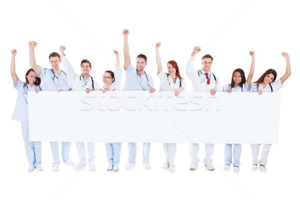 Group of healthcare personnel holding a banner Stock photo © AndreyPopov