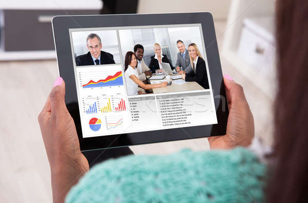 Businesswoman Video Conferencing With Colleagues From Home Stock photo © AndreyPopov