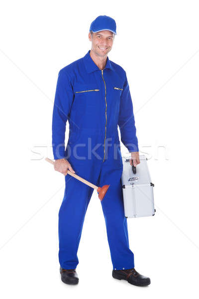 Happy Worker Holding Toolkit And Plunger Stock photo © AndreyPopov