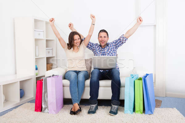 Stock photo: Excited Couple With Shopping Bag