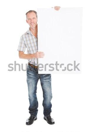 зрелый человек плакат портрет счастливым белый Сток-фото © AndreyPopov