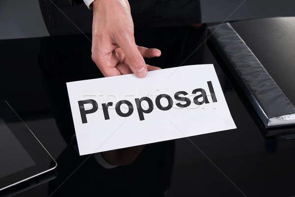 üzletember tart javaslat felirat asztal kép Stock fotó © AndreyPopov