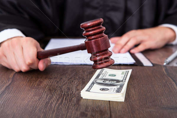 Judge Hitting Mallet On Dollar Stock photo © AndreyPopov