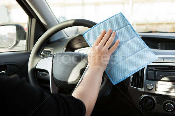 Person Cleaning Steering Wheel In Car Stock photo © AndreyPopov
