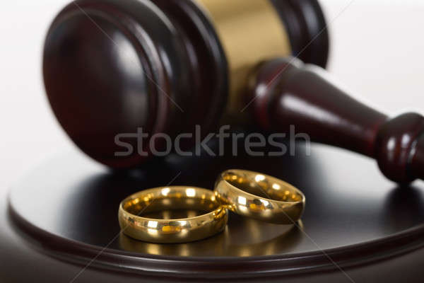 Wedding Rings And Wooden Gavel Stock photo © AndreyPopov