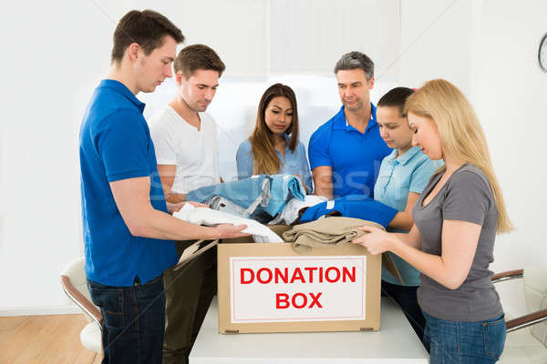 Volunteers Holding Clothes To Donate Stock photo © AndreyPopov