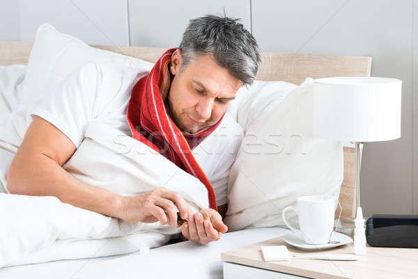 Hasta adam tıp yatak olgun kahve Stok fotoğraf © AndreyPopov